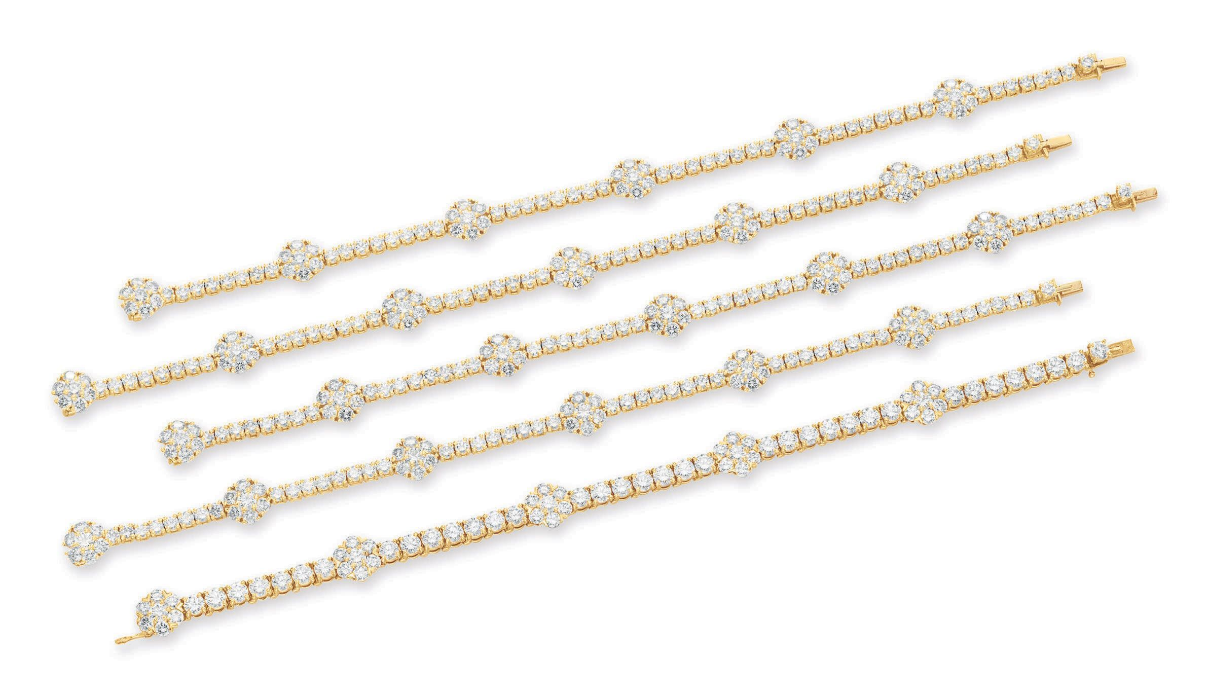 A set of five diamond and gold bracelets by van cleef u arpels each