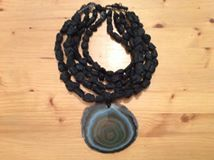 """And last but not least this fantastic necklace from the great Artist Eléna Cantacuzène and in my small collection for more than 10 years, this 5 ranks of lava beads and a big gem of agate !  Diameter of the agate : 10cm/3,93 inch  Lenght of the necklace : 45 cm/17,71 inch  Weight : 476gr  For sale now (730€) in my Gallery at 28 Galerie du Roi at 1000 Brussels and soon on my website www.halter-ethnic. com under the item """" My Lucky Finds""""  The name of this necklace is C.SIKIA"""