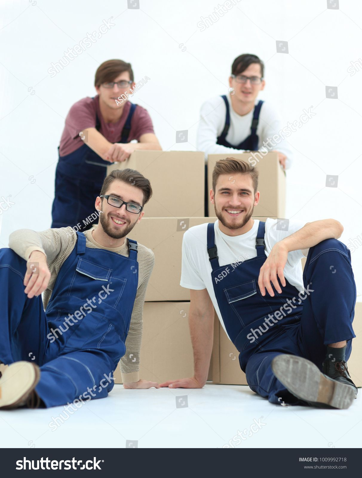 Satisfied and proud movers leaning on stack of boxes isolated on