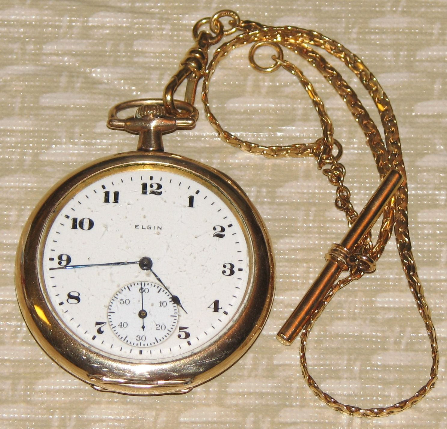 Vintage Elgin man's goldtone pocket watch with chain.  It keeps time very accurately.