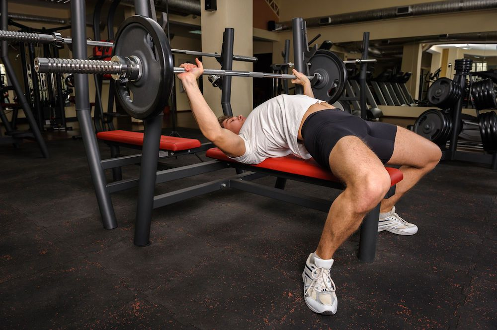 The Bench Press Arch Is It Safe To Arch Your Back Ultimate Chest Workout Chest Workout Weight Benches