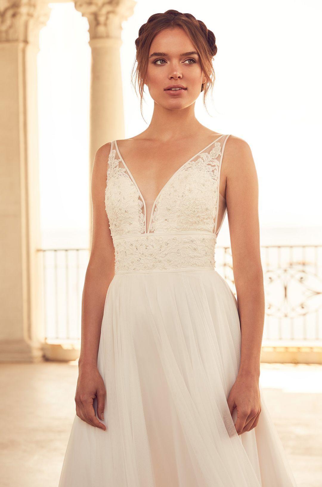 e0b600a60ae Flowing Empire Wedding Dress - Style  4787 from Paloma Blanca. V-neckline  bodice