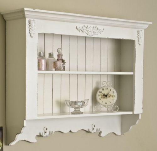ornate white wall shelf unit