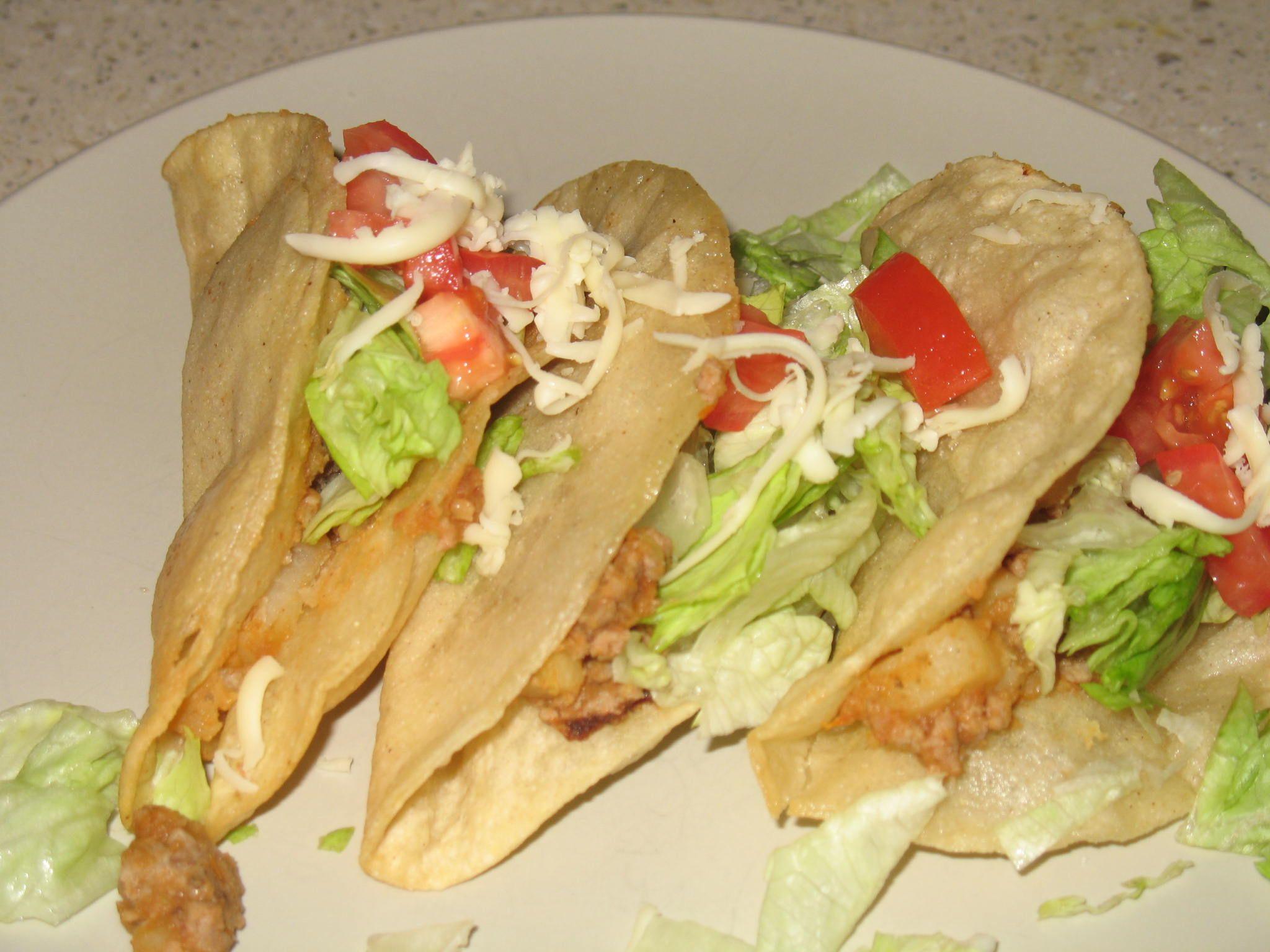 Turkey Picadillo tacos - Mexican style dish using #groundturkey #potato #tomato #mexicanfood #tacos #easycooking #corntortillas http://mykidseatsquid.com/2011/01/turkey-picadillo/