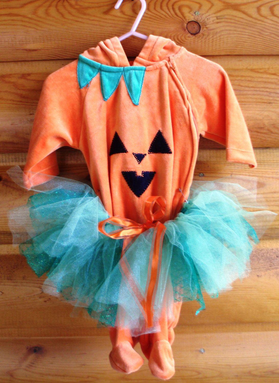 orange pumpkin sleeper onesie with green tutu halloween costume -  two piece 0-3 month outfit. $30.00, via Etsy.