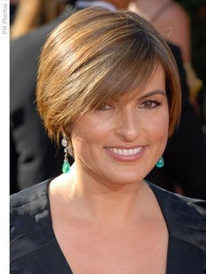 Most Flattering Short Hairstyles for Round Faces mariska-hargitay-short-hairstyle-round-face How To Style:  Apply styling crème then blow dry using a large round brush or paddle brush. If it's not smooth enough, use your flat iron (on a low setting if possible). Use hairspray sparingly.  Try  Volumizing Gel if you're looking for a little more volume