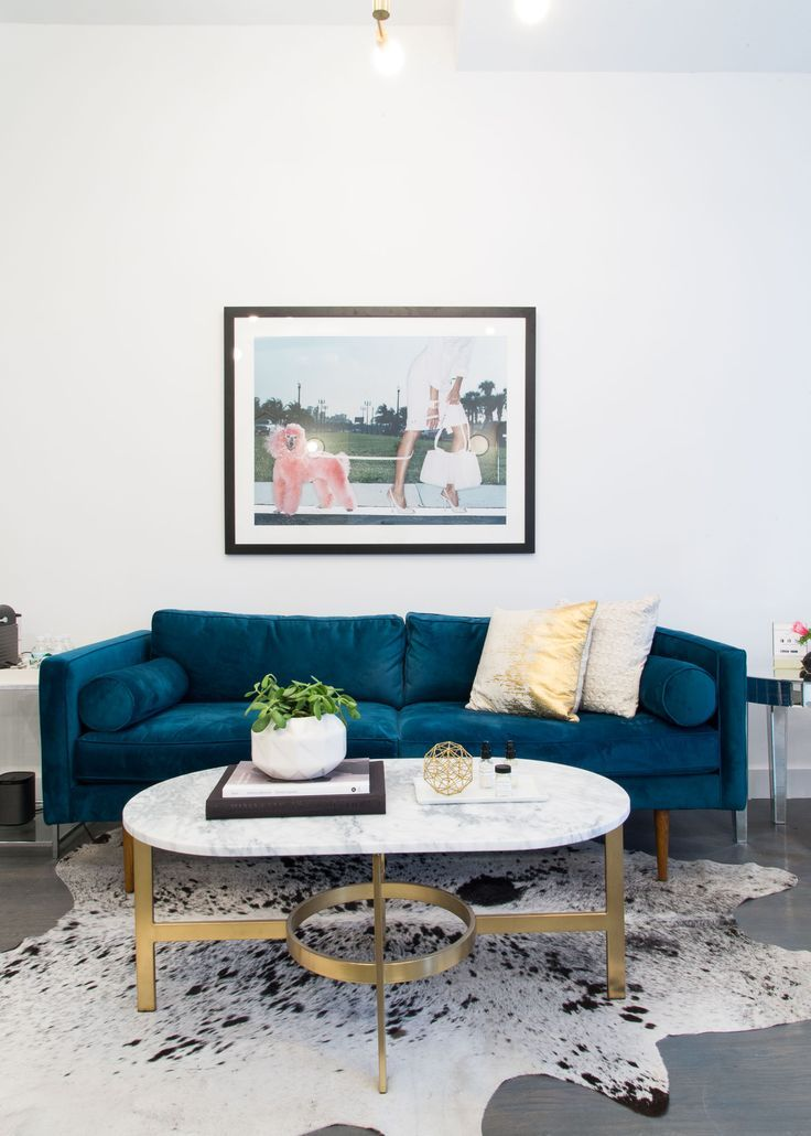 Room E With A Blue Velvet Sofa Cowhide Rug