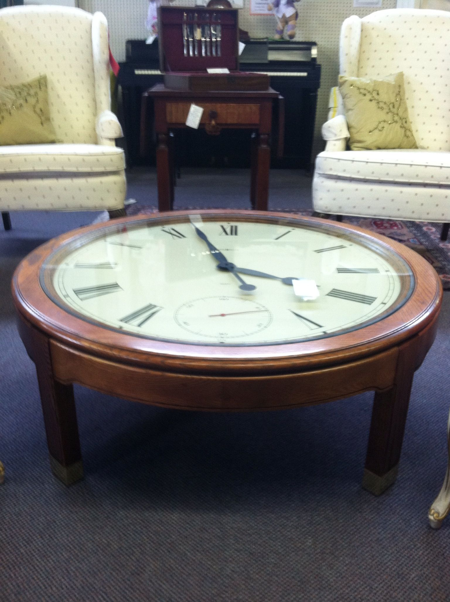 Howard Miller Clock Coffee Table in a solid oak base priced on the