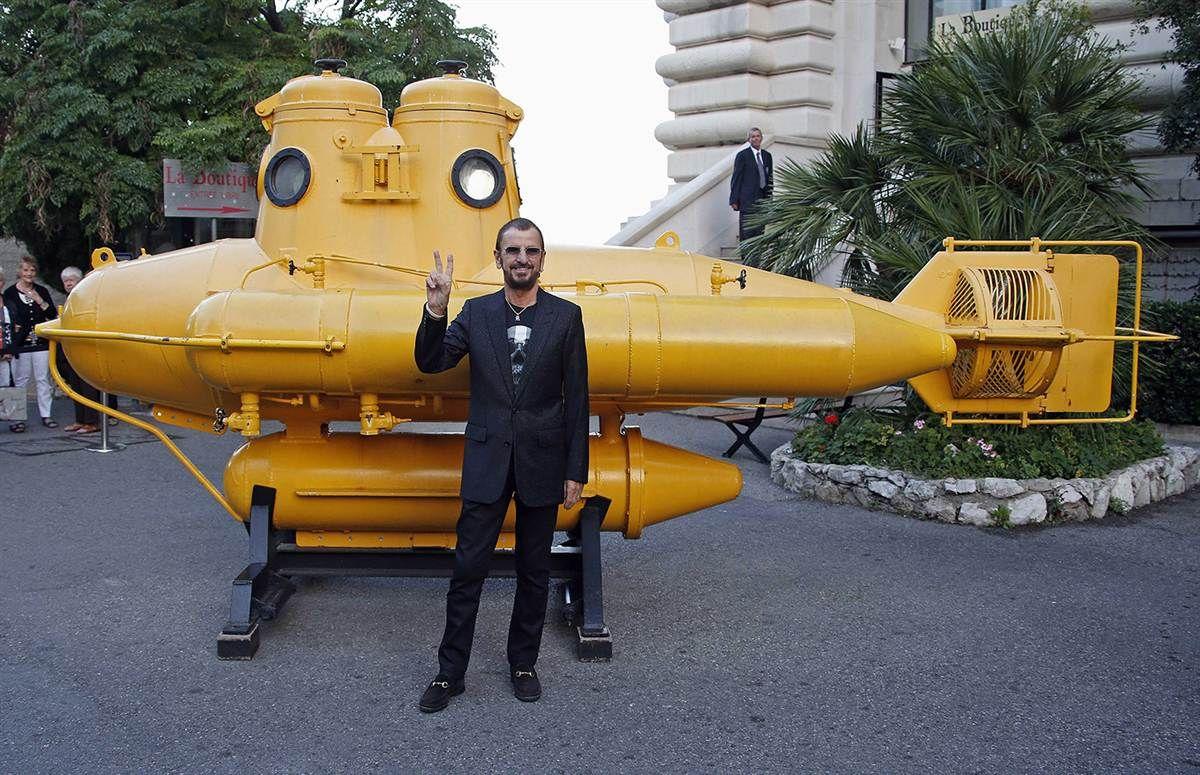 British musician and artist ringo starr poses near a