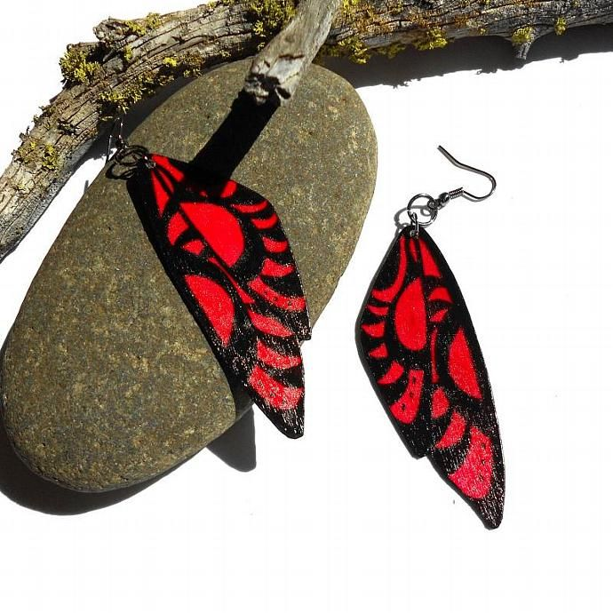 I designed these to look a bit like butterfly wings, and a bit like fairy wings. These light weight earrings are made with layers of ultra thin birch wood. The edge or each earring is also lined with black enamel. Each earring is cut by hand and then painted on both sides. I then seal each earring with a clear finish to prevent color loss or color bleed. For this pair I used a dark red and black for the design. The earring hooks are a gun metal grey color.Each earring measures about 3 1/2…