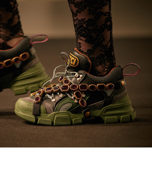 64b032d286b Sneakers crisscrossed with crystals featuring Gucci in Sega lettering in  the Gucci Fall Winter 2018 fashion show by Alessandro ...