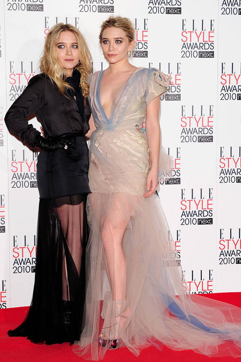 Mary-Kate and Ashley Olsen hit the ELLE Style Awards red carpet in gowns, both finished with sheer fabric for a peekaboo effect.