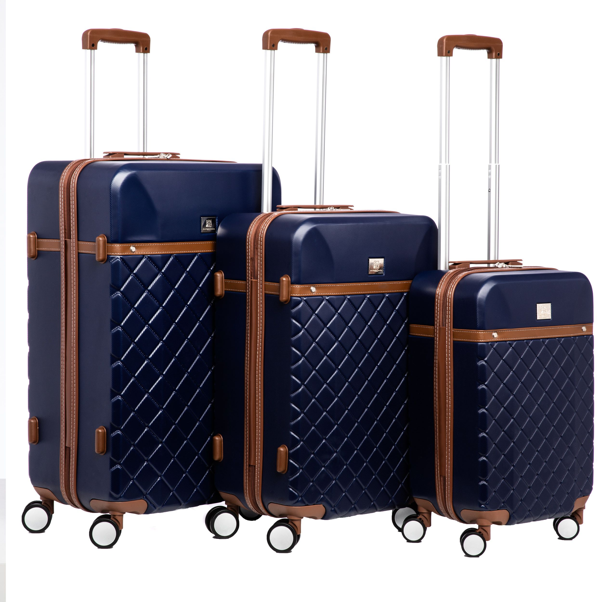 b76b0eb953dc This 3-piece Hardside Luggage Set from Anne Klein features quilted ...
