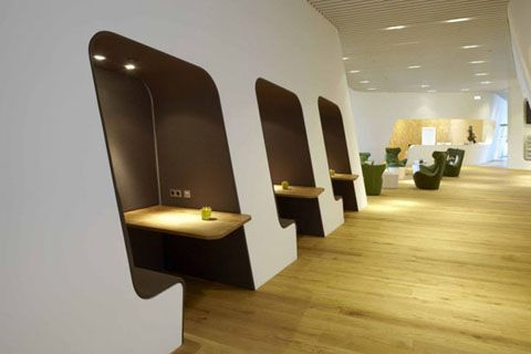 ' This Airport Design was created by Erich Gassmann and Tina Aßmann. The VIP WING Lounge at the Munich Airport was created using local materials such as felt, leather, and broad oak planks