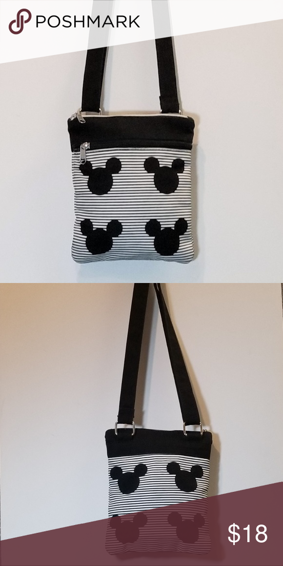 """Black and white Mickey Mouse crossover bag Disney Park's black and white Mickey Mouse crossover bag. Perfect for a day at the parks or to make you think of your time at the happiest place on earth. *7""""L x 8""""H x .5""""-2""""W *27""""-50"""" adjustable strap *1 outer zip pocket, 1 inner zip pocket Disney Bags Crossbody Bags"""