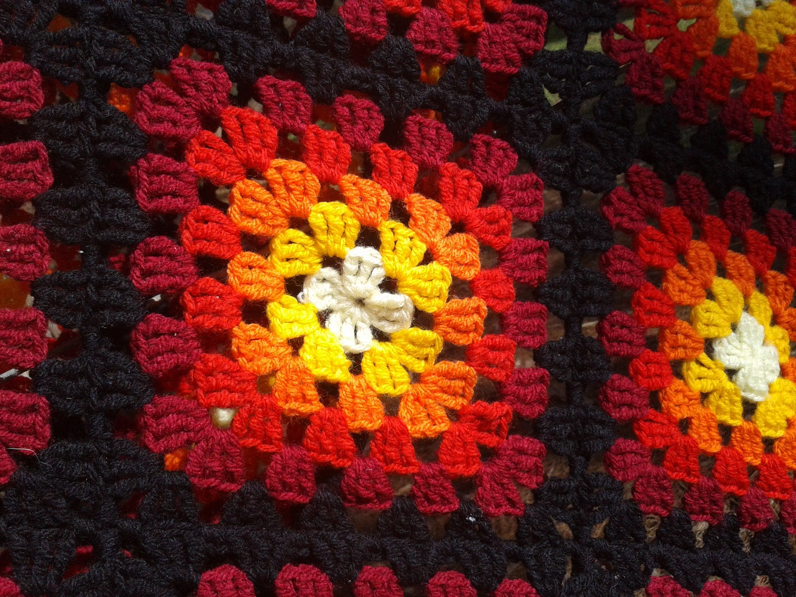 The firestarter blanketafghan notes i used a basic granny i used a basic granny square pattern yarn cant remember what size hook light yellow bright yellow orange red dark red black squares joined in black bankloansurffo Image collections