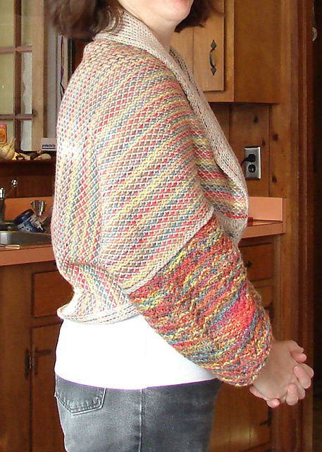 Beautiful knitweave machine knit shrug with sleeves.  I love the colors, reminds me of colored pencil drawings.
