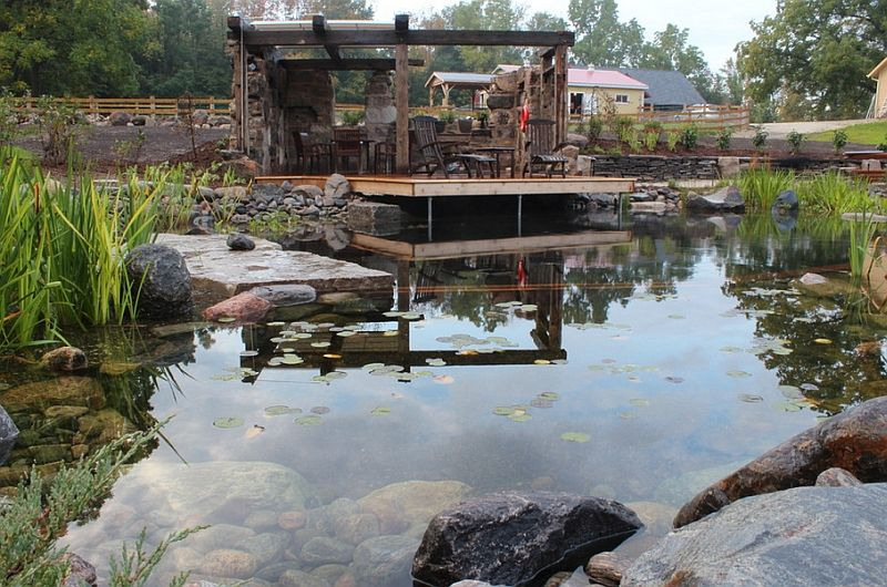Rustic Natural Pool With A Farm Backdrop And A Faux Ruin Shelter Decoist Farm Backdrop