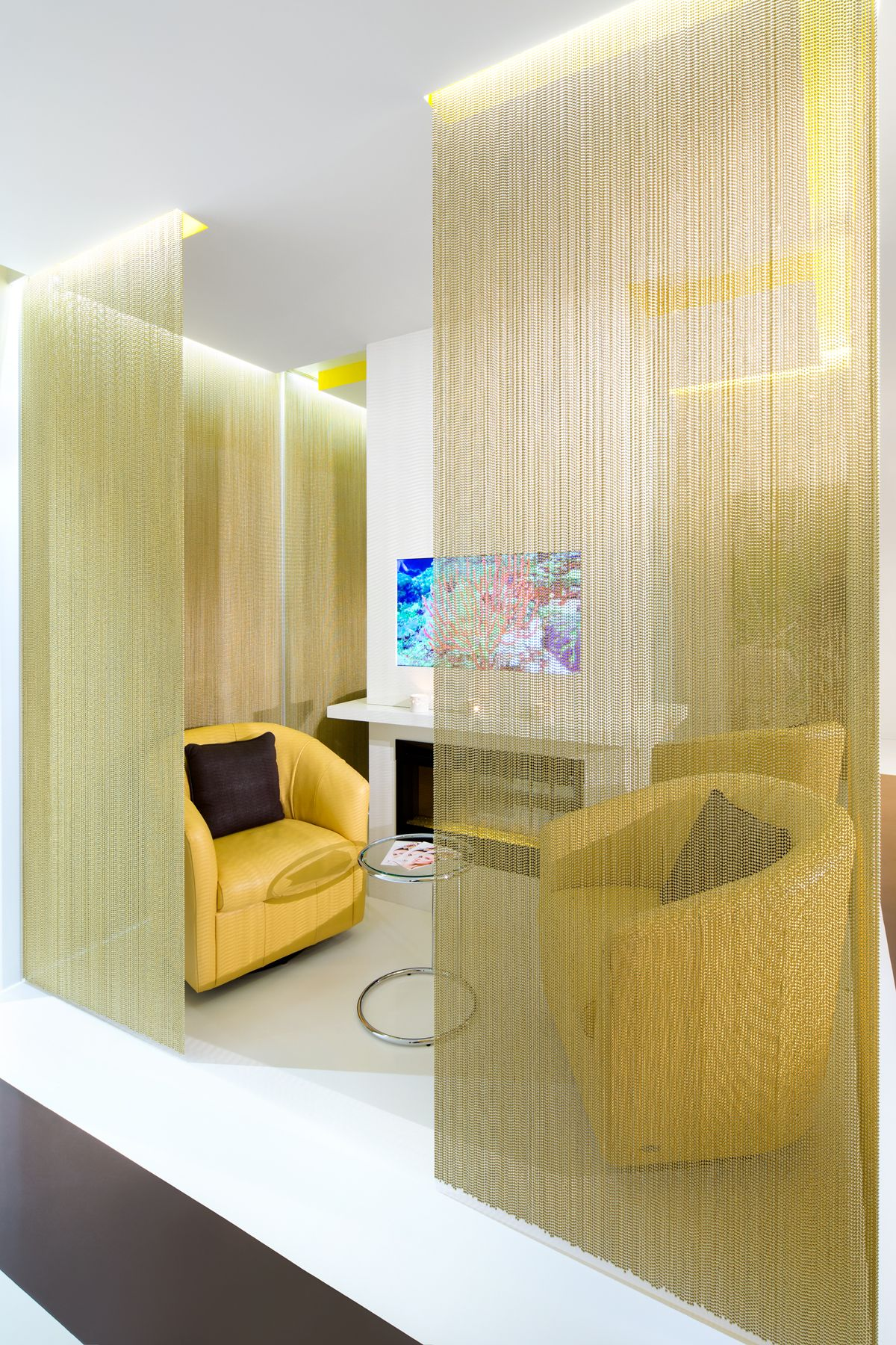 Interesting and luxurious division of space with gold curtain wellness and spa interior design tumbleweed interiors healthy harmonious sustainable