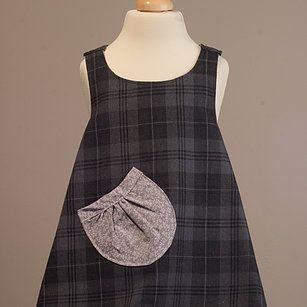 A revesible pinafore in charcoal and grey... there are no fastenings you turn it round after they've spilt dinner on it and hey presto - a clean dress!  See more beautiful handmade in Yorkshire dresses at milliz-at-ivycottage.com