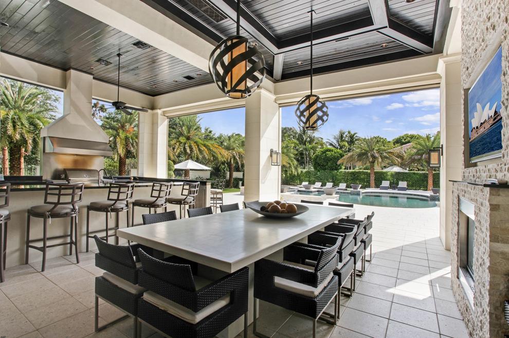 12 95 Million Newly Built Mediterranean Mansion In Palm Beach Gardens Fl Luxury Outdoor Kitchen Luxurious Backyard Outdoor Living Design