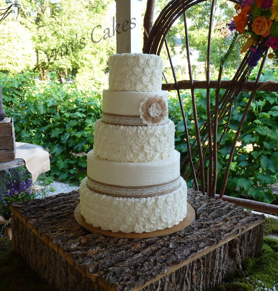 Rustic buttercream rosettes and textured brides cake with