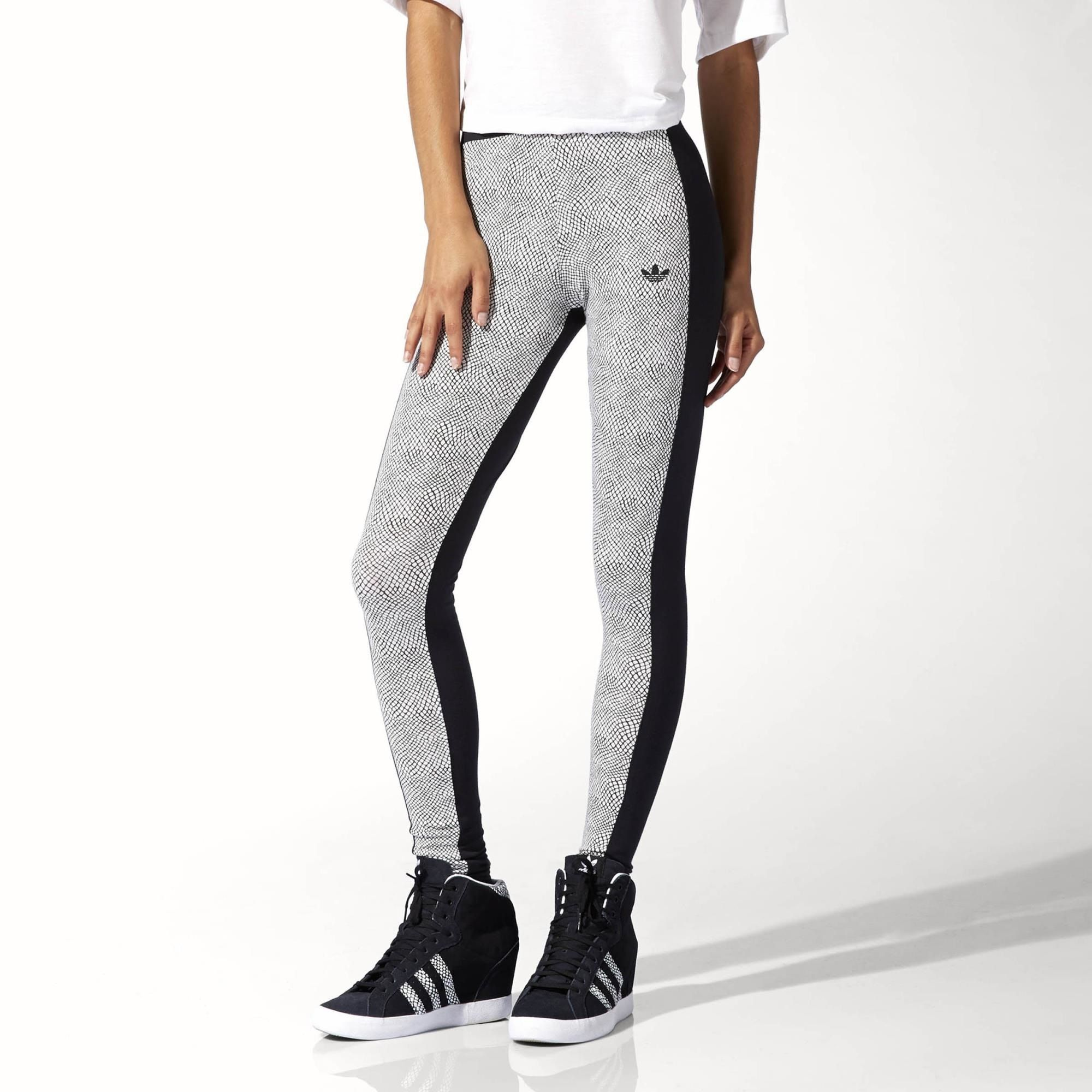 77301d64f743ec Slither into these women's leggings. They mix a tight, second-skin fit with  a scaly reptile print front and a solid back. The tights feature a tiny  Trefoil ...