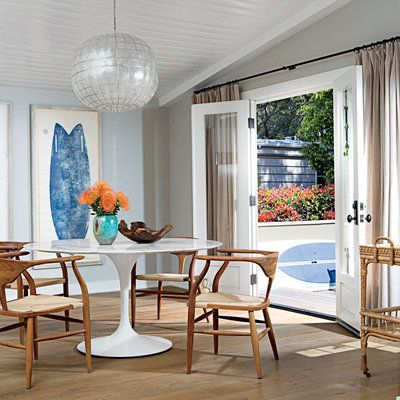 A Bold Silver And Mother Of Pearl Chandelier Contributes To The Groovy Vibes Malibu Mobile Home Dining Room Without Straying Too Far From