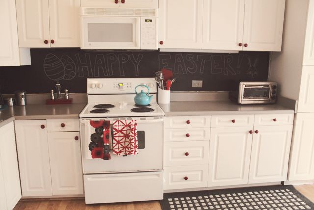 chalkboard backsplash  white cupboardsdon\u0027t love this but this