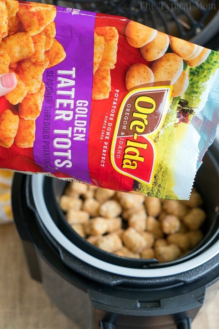 Air fryer tater tots are the bomb! Add cheese to the top