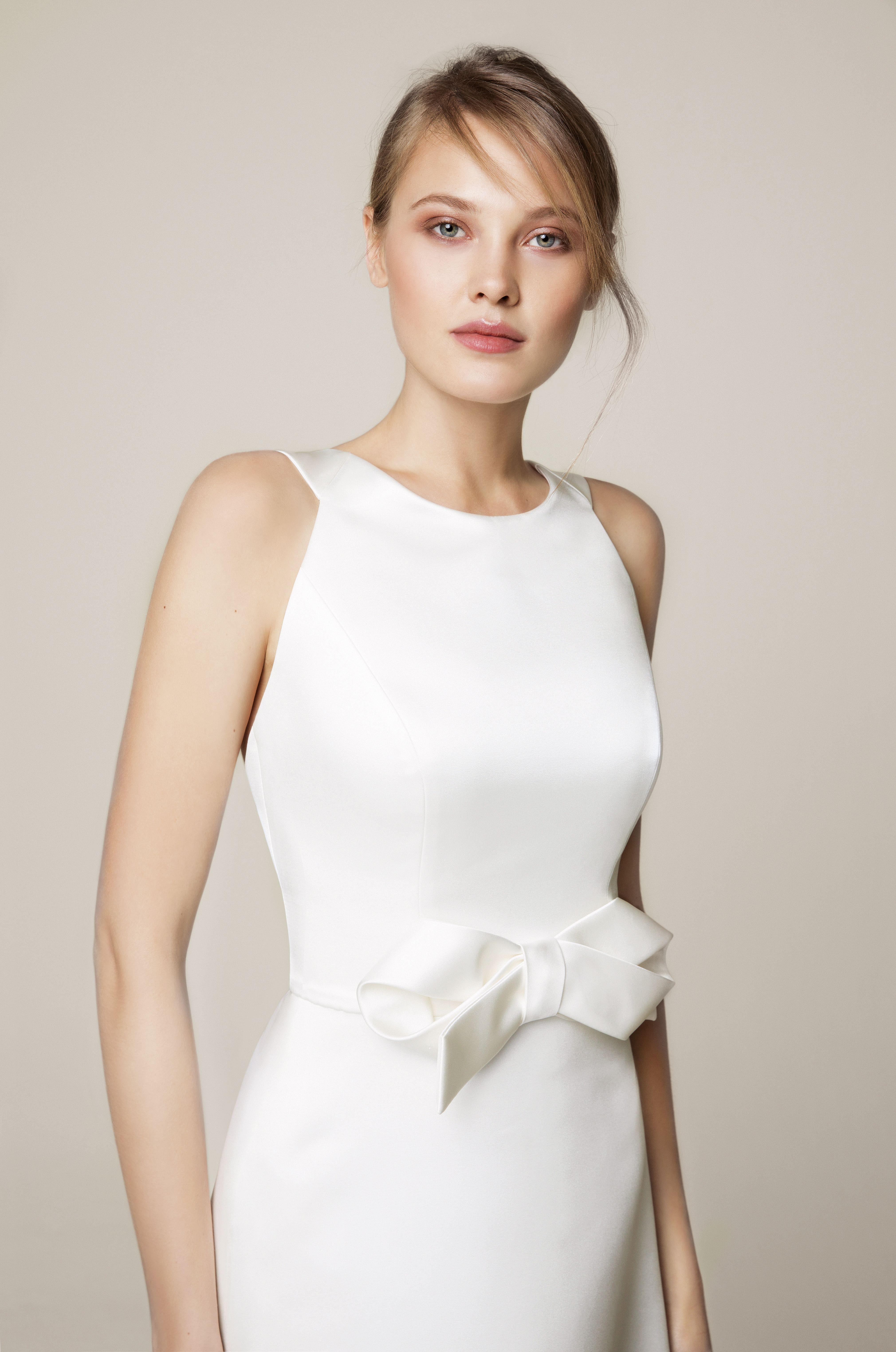 4eb195dbb92d Minimalist short sleeve crisp contemporary bow wedding dress. Jesus Peiro  wedding dresses at Miss Bush