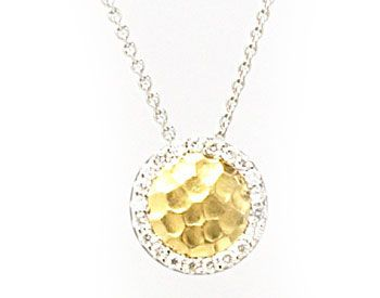 yellow gold round pendant surrounded with diamonds.