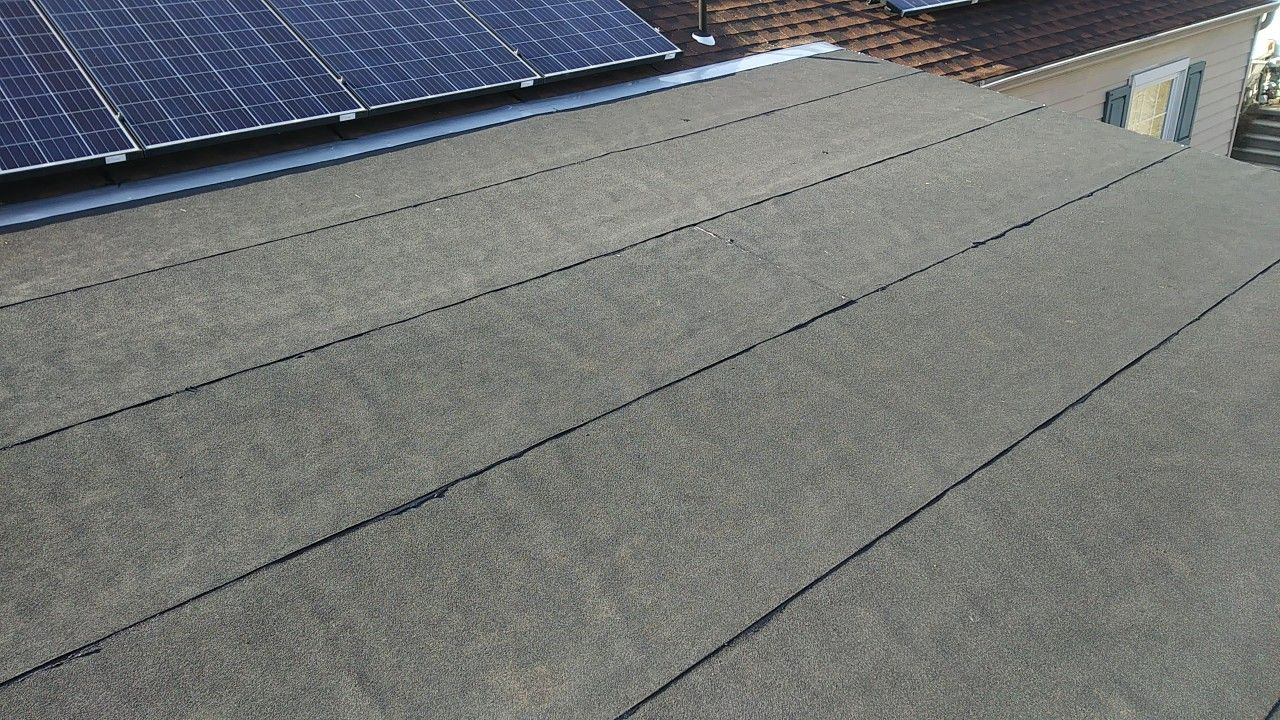 Asphalt Mineral Rolled Roofing Over Shed Style Sloped Roof