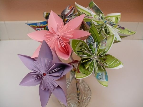 Making an origami paper flower craft bouqet of paper flowers that includes a pink flower a purple flower and 3 multi mightylinksfo