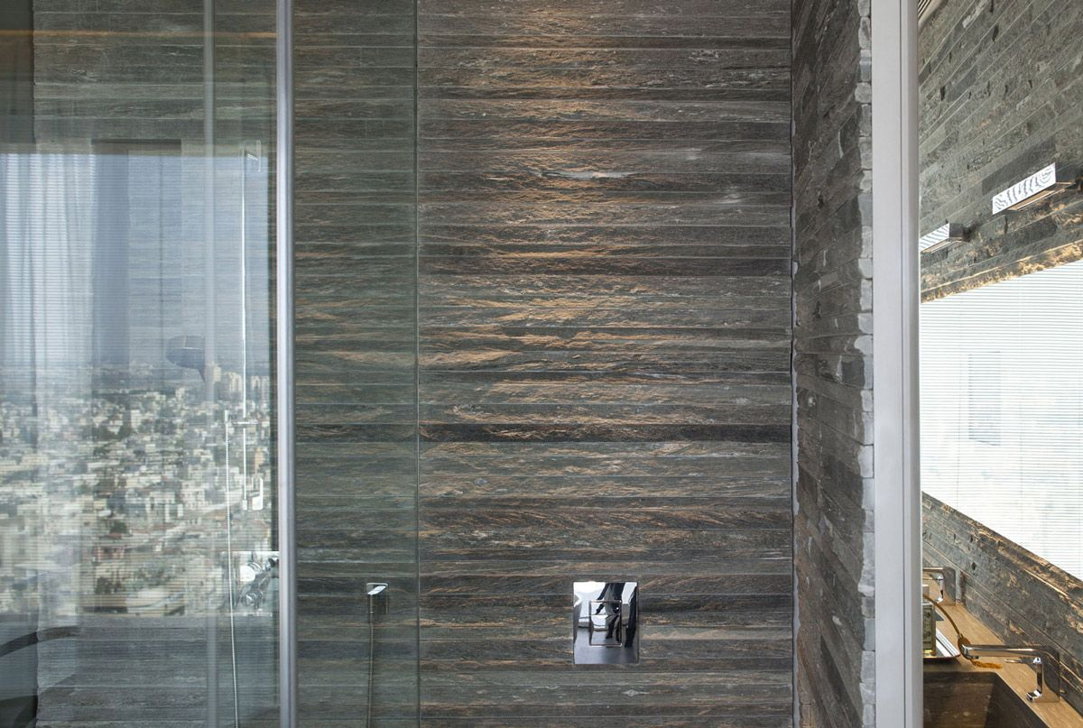 bathroom rough stone tiles elegant apartment with reflective ceiling in tel aviv israel
