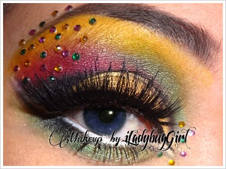 A spectrum of eye shadow colors accented by multicolored crystals.