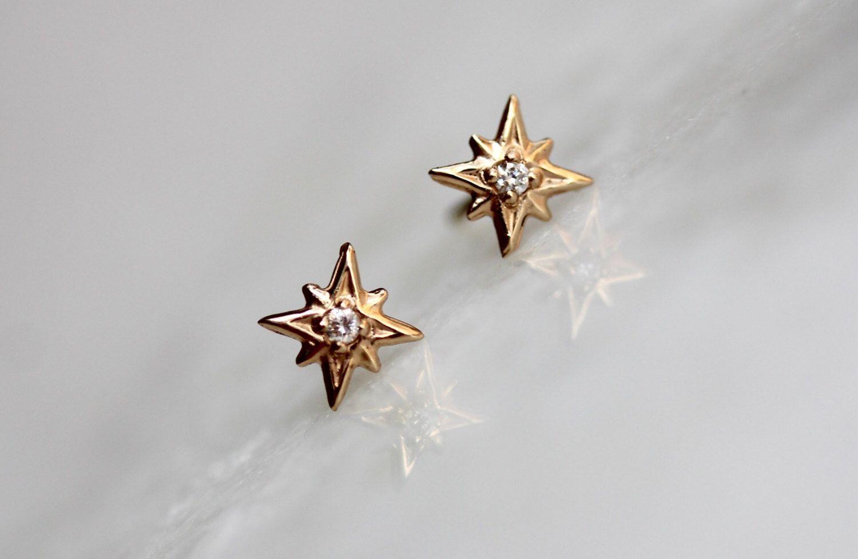 14k Gold Diamond North Star Studs, Diamond Studs, Diamond Earrings, Real Gold, Star Studs, Star Earrings by LieselLove on Etsy https://www.etsy.com/listing/274163208/14k-gold-diamond-north-star-studs