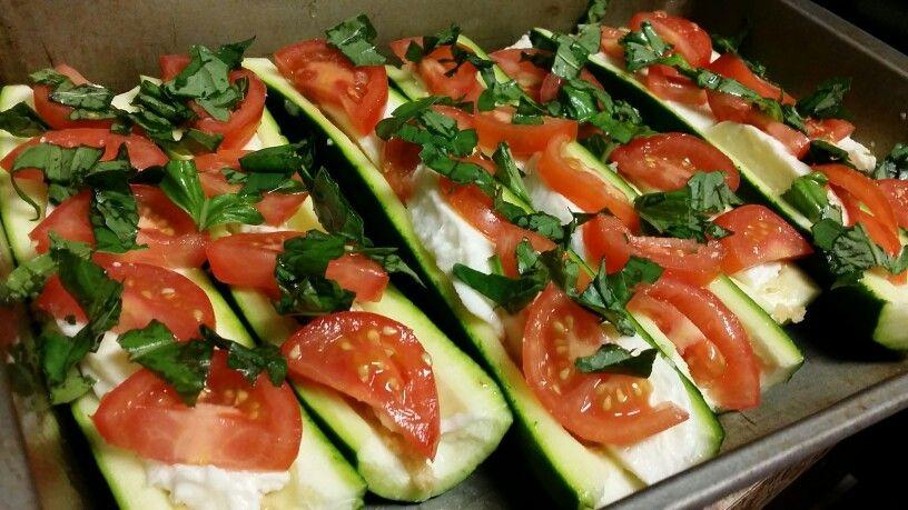 Zucchini boats stuffed with garlic, fresh mozz, tomatos, basil and balsamic vinaigrette. Bake at 350 for 20 mins
