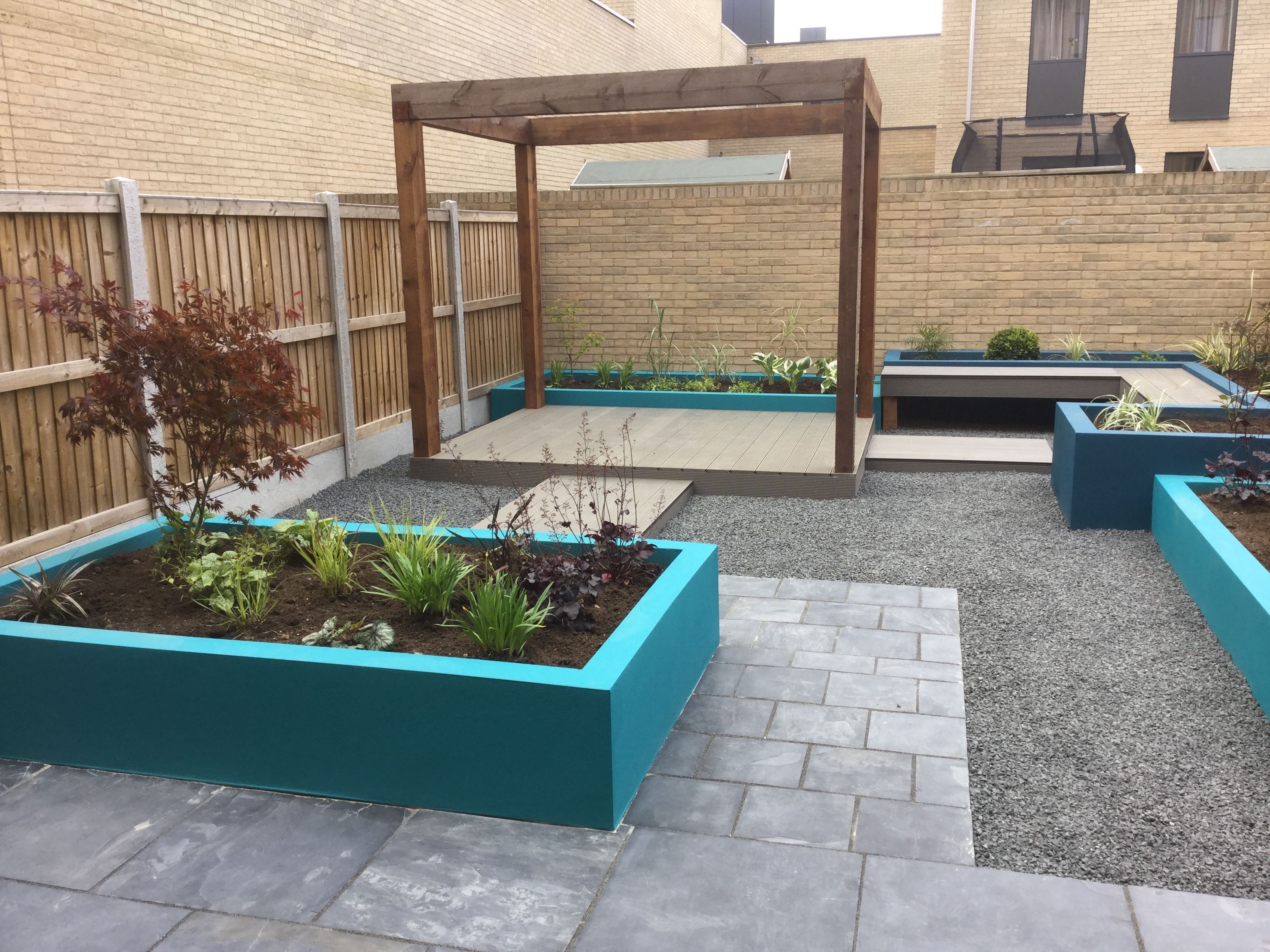 contemporary garden design in cambridge with raised planters and