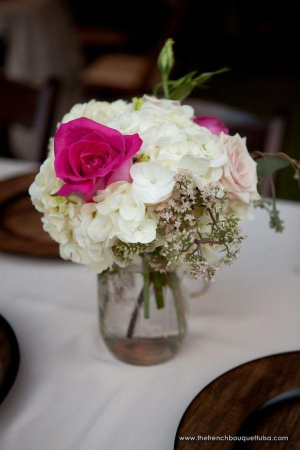 Feminine and chic floral centerpiece of white pink in
