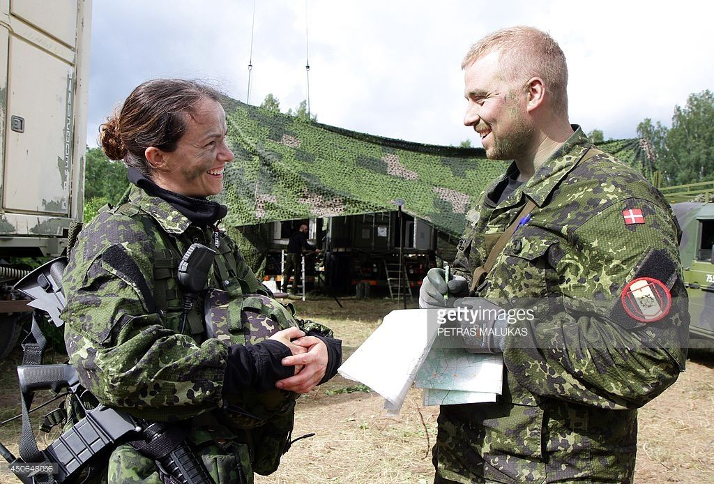 Soldiers from the 2nd Brigade of the Danish Division chat as they ...
