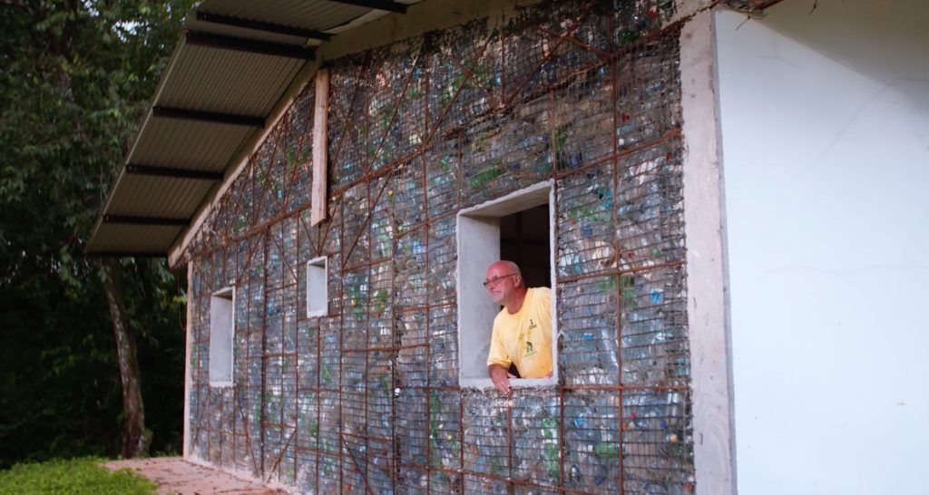 Surprisingly The Plastic Bottle Houses Are Well Insulated And Resistant To Earthquakes The Activist Aims To Plastic Bottle House Bottle House Plastic Bottles