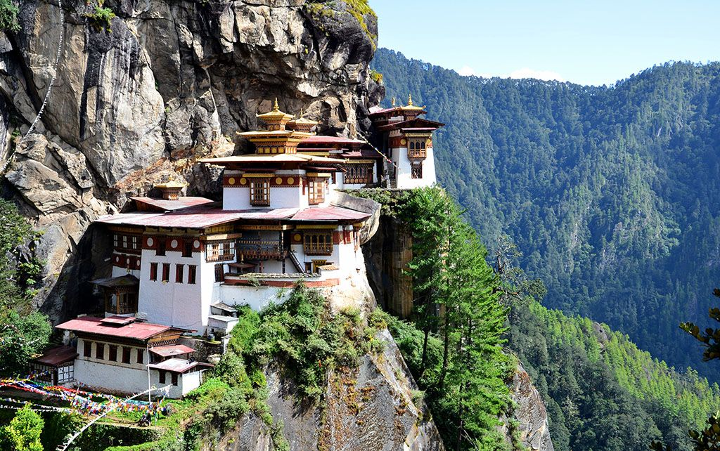 Tiger's Nest Monastery, Paro Valley, Bhutan \\ This 17th century temple sits on the edge of a cliff 3,000 feet above the Paro valley. The holy site was built to protect the cave in which Guru Padmasambhava, a leader of Buddhism, meditated for three years, three months, three weeks, three days and three hours.