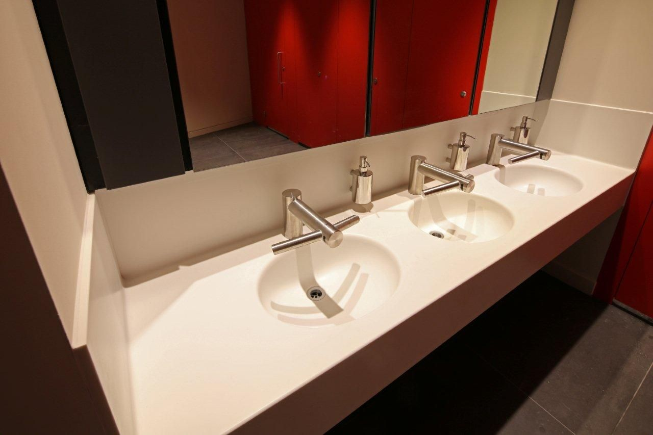 Individually shaped corian sinks installed at the