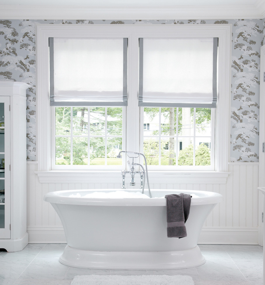 Freestanding Tub Infront Of Windows With Simple Roman Shades