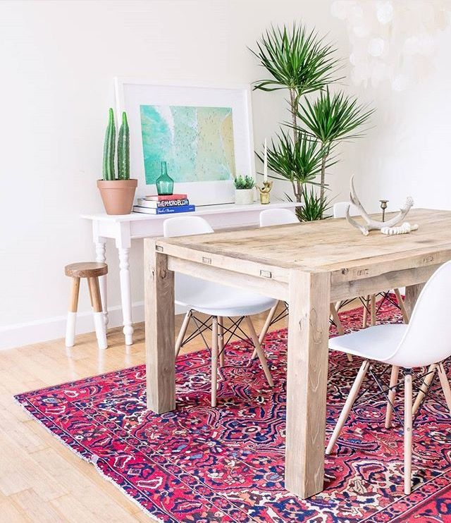 Plants + natural wood / via grey malin Staged  Dining Room