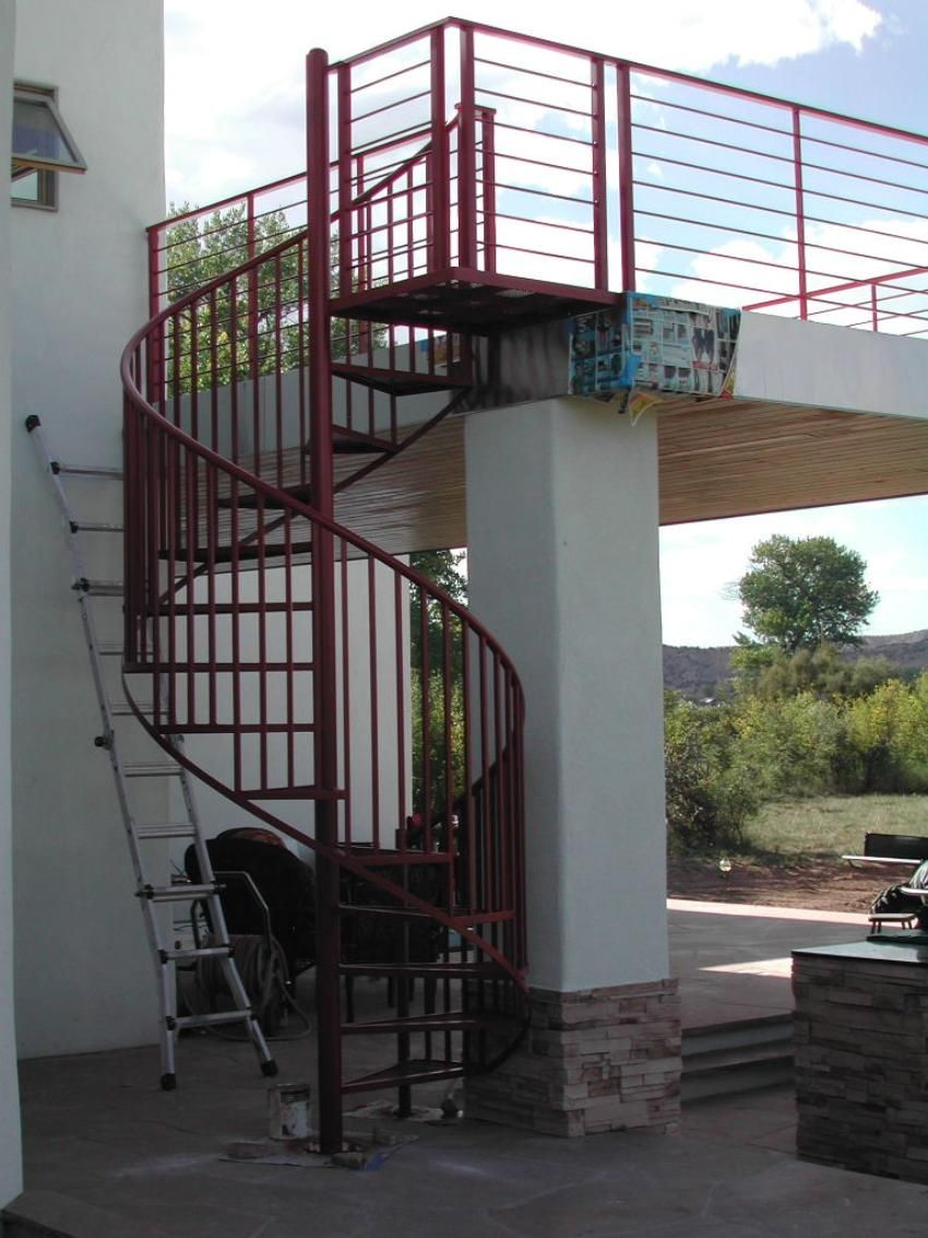 This standard spiral stair with expanded metal treads and vertical balusters bined with the contemporary 8 line horizontal deck railing