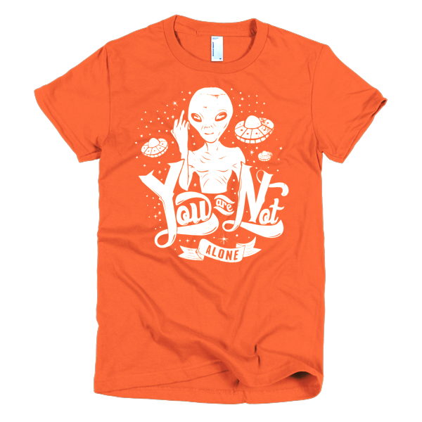 this little grey alien is just a rude fella flipping the bird to the people of earth you are not alone this t shirt proclaims with classic flying saucers