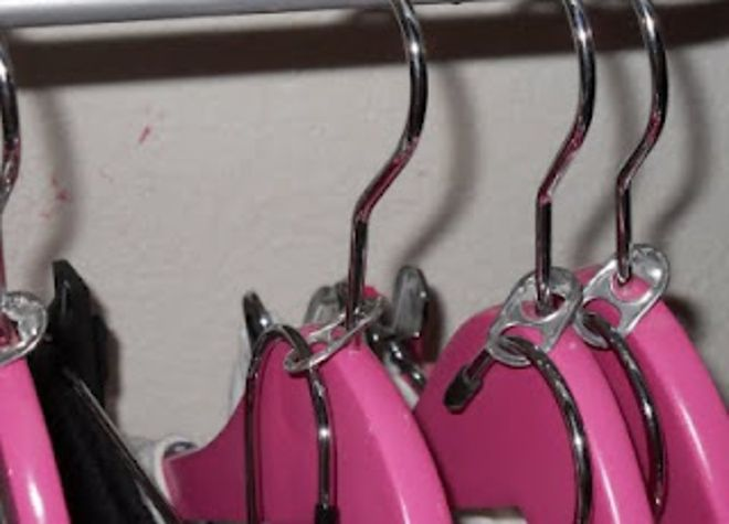 Hang multiple garments in one spot with soda can tabs.