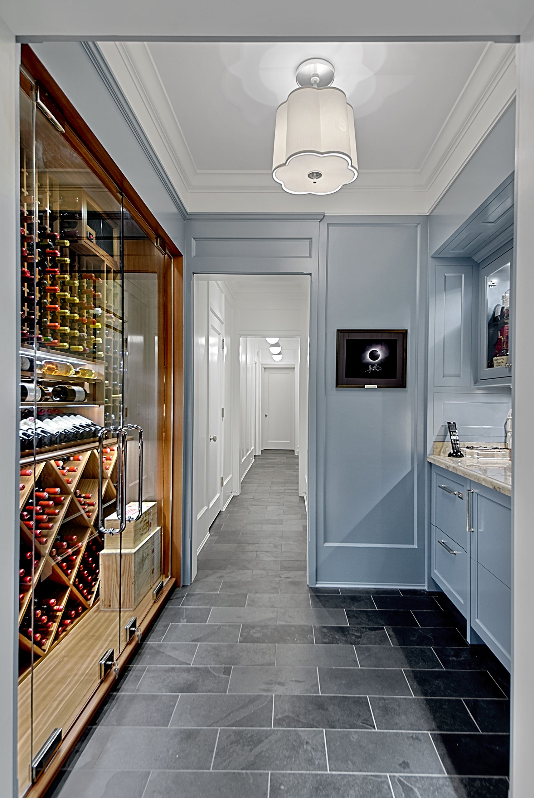 Custom wine in butlers pantry has full height